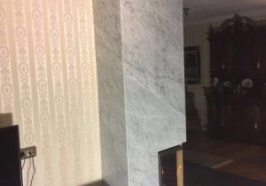 Bestaande haard bekleed met Bianco Carrara